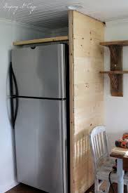 how to build a cabinet around a refrigerator keeping it cozy kitchen update building a refrigerator cabinet