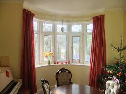 interior red bay window curtains on the yellow wall with round red bay window curtains on the yellow wall with round dining table and modern seat can add the beauty inside modern house design ideas with warm lamp