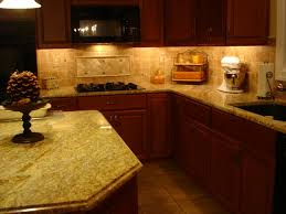 cream granite countertop with large ogee edges above brown wooden