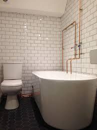 metro tiles jenny u0027s industrial bathroom walls and floors