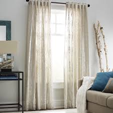 loving these shimmery winter tree curtains from pier 1