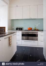 black and white kitchen floor images black floor tiles in modern white kitchen with glass splash