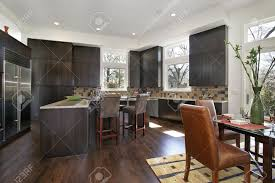 modern kitchen with island and eating area stock photo picture