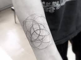 geometric fine line tattoos by los angeles famous tattoo artist dr