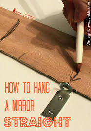 straighten up how to hang a mirror or picture frame