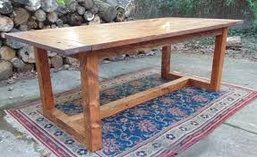 hand crafted modern chunky farmhouse table by wonderland woodworks