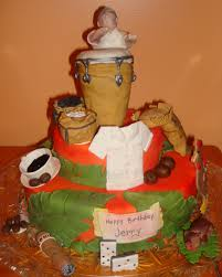 old puerto rico house cake with domino and puerto rican flag