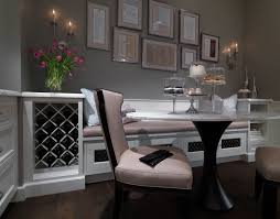 wine storage and a bench seat turn this kitchen into an
