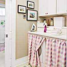 stacked full size washer and dryer great for an upstairs laundry