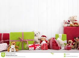 red and green christmas presents with teddy bears on white backg