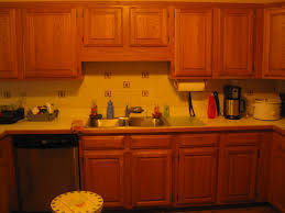glazed kitchen cabinets before and after painting melamine kitchen