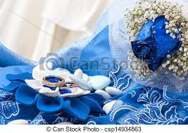 white and blue roses a blue roses and wedding rings on white background stock image