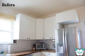 how to make cabinets appear taller how i closed the space above my cabinets a butterfly house
