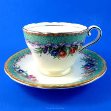 pretty green border and colorful crocus floral aynsley tea cup and