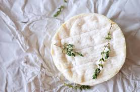 cheese wrapping paper brie cheese on wrapping paper with thyme herbs stock photo image