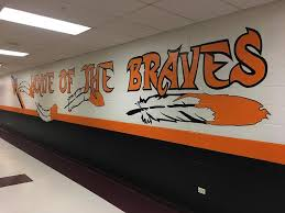 seventh eighth graders paint murals on sandwich middle school a student painted mural cheers on the braves at sandwich middle school