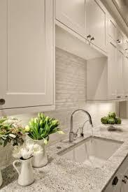 light granite countertops with white cabinets andino white granite white beveled matte finish subway tile