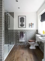 alcove shower traditional gray tile and subway tile dark wood floor and brown floor alcove