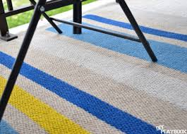 Yellow And White Outdoor Rug How To Paint This Diy Outdoor Rug In Three Easy Steps Diy Playbook