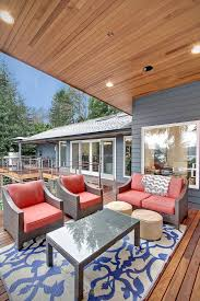 Woven Outdoor Rugs Impressive Deck Color Schemes With Red Cushions Blue And White Rug