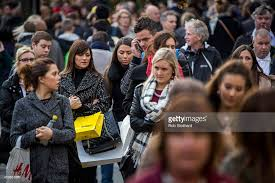 black friday bargain hunters hit the streets photos and images