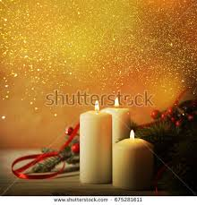 christmas candles ornaments over dark background stock photo