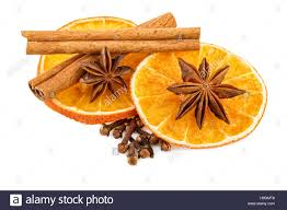 dried orange slices with cloves and cinnamon sticks traditional