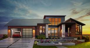 why tesla u0027s new solar roof tiles and home battery are such a big