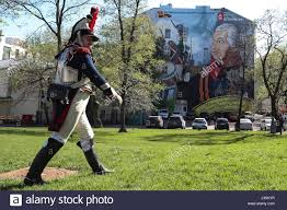 moscow russia 3rd may 2017 a man in a period costume by a wall a man in a period costume by a wall mural on the side wall of a house at volkhonka street central moscow showing field marshal of the
