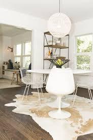 cowhide rug under dining room table u2022 dining room tables design