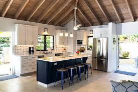 white kitchen cabinets with wood beams coastal white and navy kitchen with exposed beam ceiling