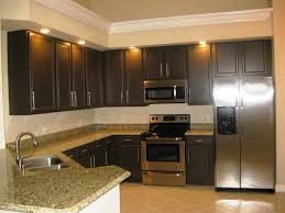 painted kitchen cabinets with wood trim finishing the kitchen