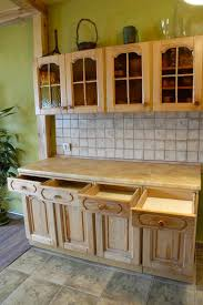 should i decorate on top of my kitchen cabinets decorate the tops of kitchen cabinets 5 innovative ways