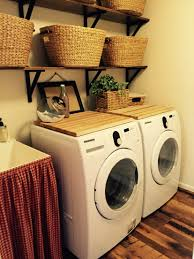 small laundry room decor to hide drain and plugs behind washer