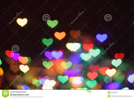 abstract color christmas light background hearts stock photo