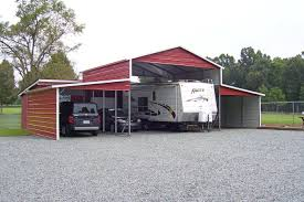 multi use building red and white trim rv cover and vehicle