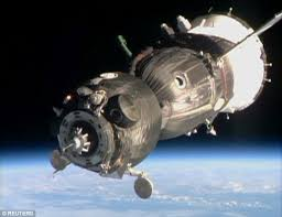 iss astronauts forced to evacuate into russian soyuz to dodge