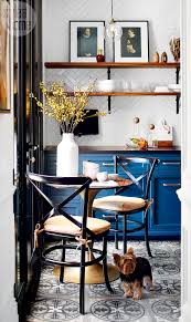 a parisian bistro inspired kitchen style at home a trio of industrial style pendant lights and open shelves with iron brackets reflect all the hallmarks of a french bistro to keep everything neat