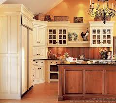 traditional antique white kitchen cabinets with beadboard