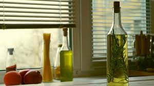 Kitchen Background Cooking Oil Bottle On Kitchen Background Olive Oil With Rosemary