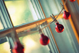 new year window sun light rope bulbs clothespin