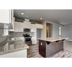 Craftsman Style Open Floor Plans Modern Craftsman Style Home With White Shaker Cabinets And An