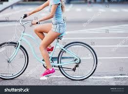 bike riding sneakers young womens tan legs wearing pink stock photo 584406778