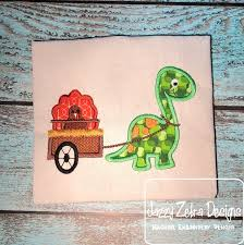 dinosaur pulling cart with turkey appliqué embroidery design