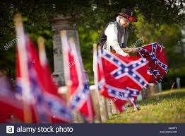 Confederacy Flags A Confederate Re Enactor Places Confederate Flags On Tombs Of