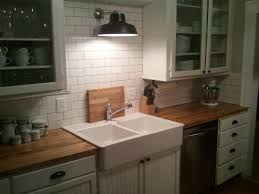 our small kitchen diy remodel in north dakota ikea farmhouse sink our small kitchen diy remodel in north dakota ikea farmhouse sink ikea butcher block countertops lowes warehouse pendant and home depot subway tile