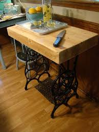 creative ways to reuse your old sewing machine table kitchen island butcher block upcycled old sewing machine table
