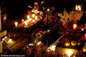 day of the dead decorations photo of day of the dead candles and flowers decorating xoxocotlan
