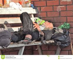 homeless man sleeping on a bench editorial image image 45438575