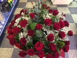Traditional Flower Arrangement - traditional red roses hand tied flower arrangement